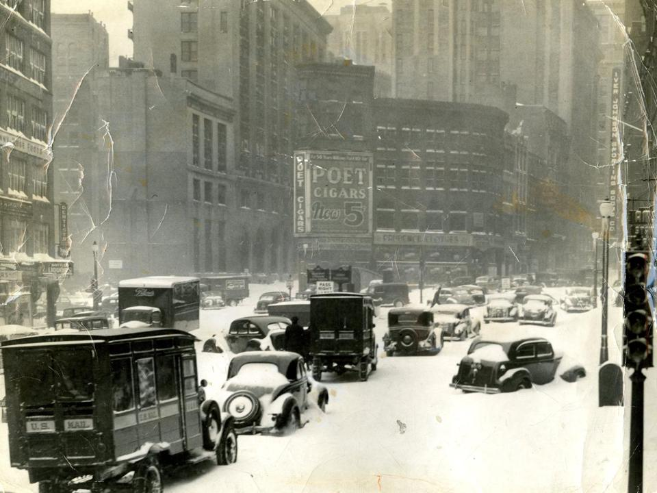 Feb. 14, 1940: Automobiles on Adams Square in Boston were stalled out in the heavy snow. From the time the snow started at 3 p.m., it fell at at a rate of more than an inch an hour for the first nine hours. Winds reached gale force of 60 miles per hour, and it whipped the snow into impenetrable drifts.